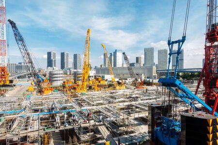 Big construction crane working in big construction site in Tokyo Japan