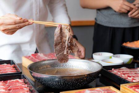Cooking of japanese wagyu beef Shabu Shabu set hot pot