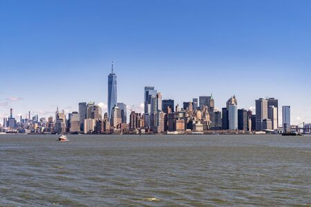 Lower Manhattan of NYC New York City taken from liberty island. This also known as Downtown Manhattan or Downtown New York the largest business district in state of New York and USA.