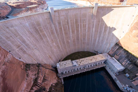Glen Canyon Dam with Lake Powell in the Desert rural area of Page city Arizona, United States. USA Landmark environmental water resources reservoir and electricity concept. Zdjęcie Seryjne