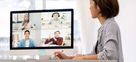 Panorama asian businesswoman work from home involved video conference meeting to corporate colleague for discuss brainstorm distantly. This technology is popular after coronavirus COVID-19 spreading