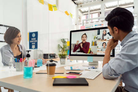 Two asian businessperson work from home office involved video conference meeting to corporate colleague for discuss and brainstorm distantly. This technology is popular after COVID-19 spreading