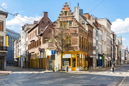 Cityscape of Meir shopping street road in Antwerp downtown in Belgium with tram track. EU Belgium city landmark and shopping center for tourism and travel destination concept. Éditoriale