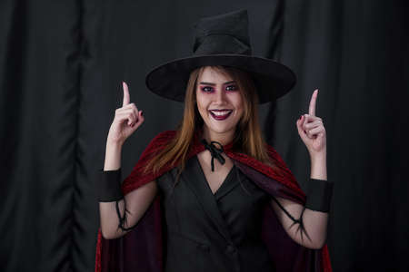 Portrait of asian young adult teenage woman wear Halloween costume cloth for Halloween party carnival. Halloween celebrate and international holiday concept. Reklamní fotografie - 156940663