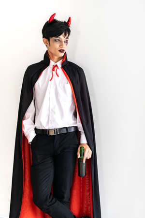 Portrait of asian young adult teenage man wear Halloween costume cloth for Halloween party background. Halloween celebrate and international holiday concept. Reklamní fotografie