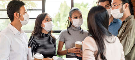 Panoramic web banner crop. Group of business worker team meeting and brainstorm for startup new business. They wear protective face mask in new normal office preventing coronavirus COVID-19 spreading.