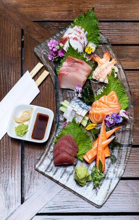 Variety of gourmet Sashimi set japanese freshness cuisine Salmon Tuna Otoro Saba Hamachi Octopus and shrimp meat. Restaurant gastronomy food and drink consumerism concept.