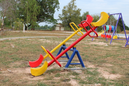 teeter: Toys on the playground in the park.