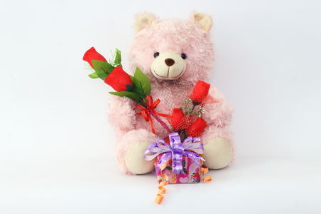 Teddy bears, pink and red roses and gift box on a white background.