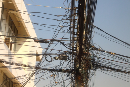era: Power poles and many telephone lines in the communication era without borders.