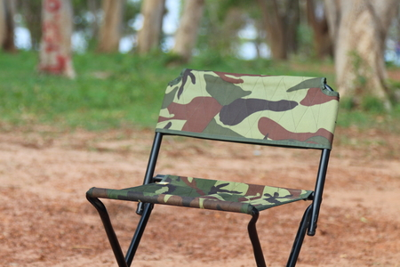 collapsible: Picnic chairs are located in the garden. Stock Photo