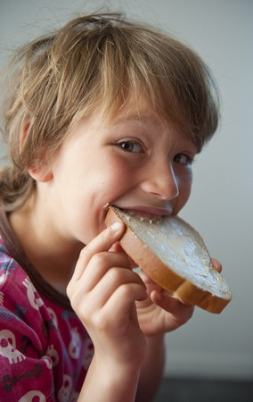 Young boy eating a sandwich photo