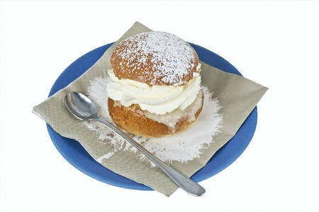 Cream bun on a plate Stock Photo