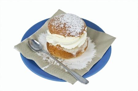 Cream bun on a plate Stock Photo