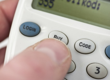 checkout button: Pressing the buy button to complete an electronic transaction
