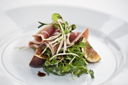 aperitive: A portion of sliced serrano with salad, sprout and sliced fig  Stock Photo