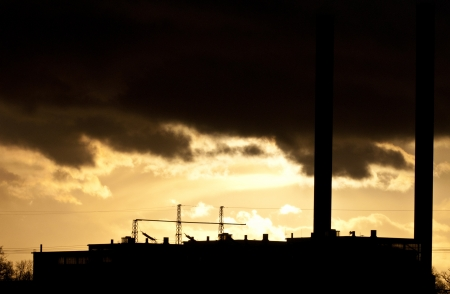 spew: Industrial plant spewing out fumes from three chimneys