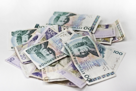 A heap of swedish currency on white background Stock Photo