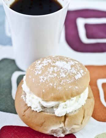 A traditional swedish cream bun, semla, and a cup of coffe
