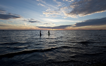 Two young boys going for a night svim in the ocean Stock Photo - 21269948