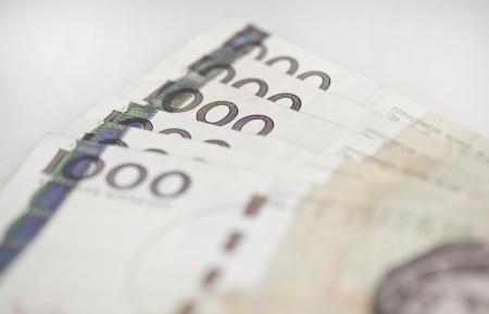 Closeup of some swedish 1000 bills on white background Stock Photo