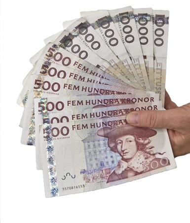 Handfull of swedish 500 and 1000 bills isolated on white background