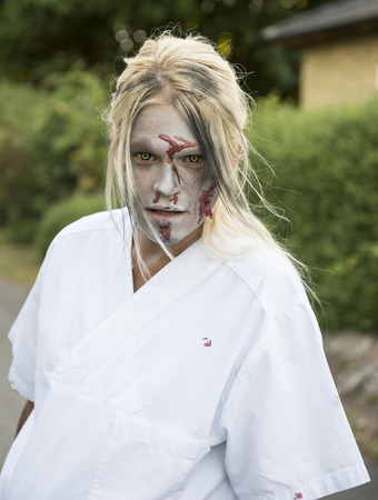 Female blonde zombie nurse out in the streets