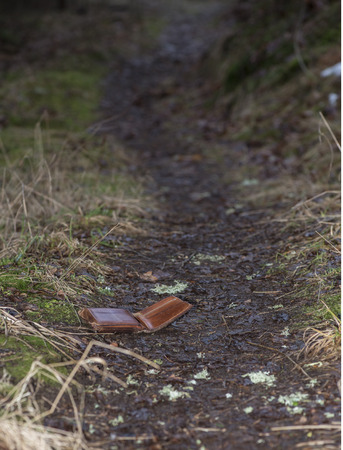 Leather wallet lost on walking track in forest