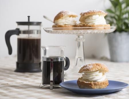 Coffee table set with creamy almond bun Imagens