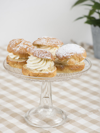 Almond buns on a glass plate