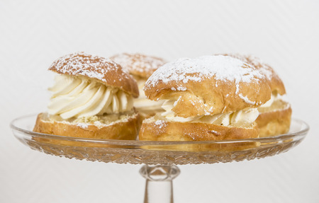 Closeup of creamy almond buns on a glass plate