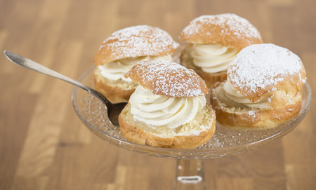 A plate filled with creamy almond buns