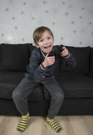 Young caucasian preteen playing a video game