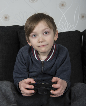 joy pad: Young caucasian preteen playing a video game