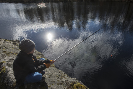 Springtimes first fishing trip for ypung boy