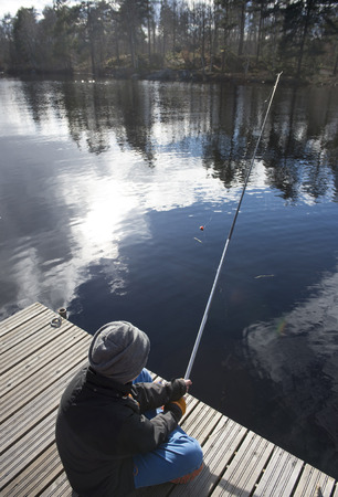 Springtimes first fishing trip for a young boy Imagens