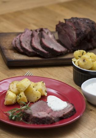 potatoe: Lamb chop on a red plate served with potatoe. Stock Photo