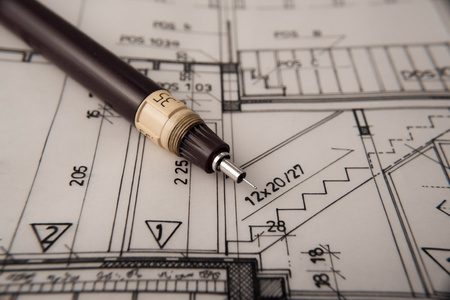 architectural plan,technical project,drawing technical letters,close up ,architect at work,Divider laying on the architectural plan,planning of interiors design on paper---more in my portfolio Stock Photo - 9323233
