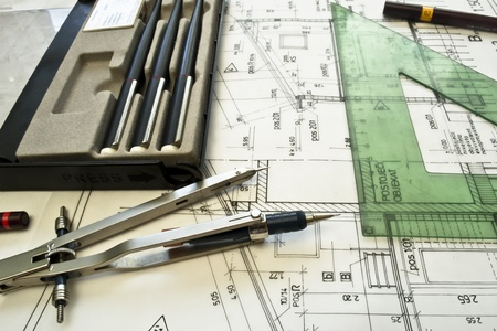 architectural plan,technical project,drawing technical letters,close up ,architect at work,Divider laying on the architectural plan,planning of interiors design on paper---more in my portfolio photo