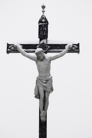 Crucifixion - Jesus on the cross by winter snow photo