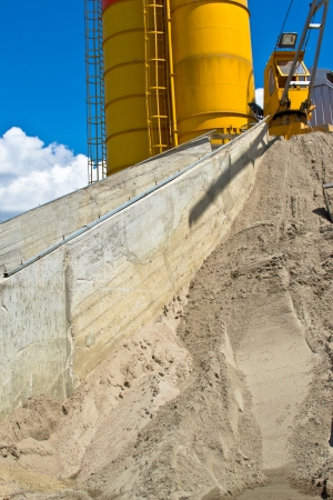Heap of sand elimination with yellow silo photo