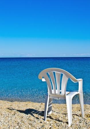 mediteranean: plastic beach chair on shore near sea Stock Photo