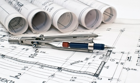 heap of design and project drawings on table background Archivio Fotografico