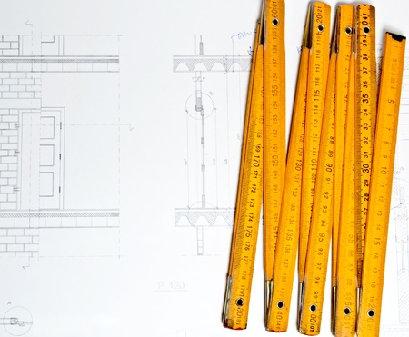restauration: architect design and project drawings on table background