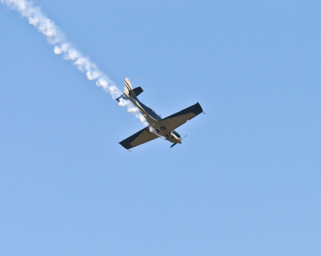 stunts: stunt plane trailing smoke