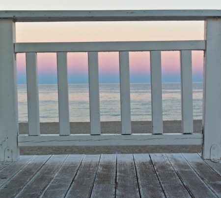 terrace with romantic sunset sea view photo