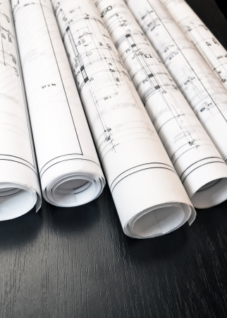 Architect rolls and plans blueprints estate project Stock Photo