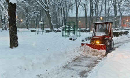 wheeled tractor: snowplow Tractor cleaning snow in the park