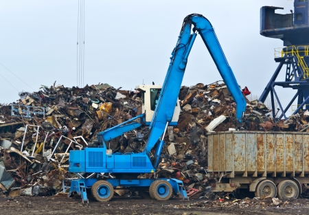 scrap iron: Cranes for recycling metallic waste Stock Photo