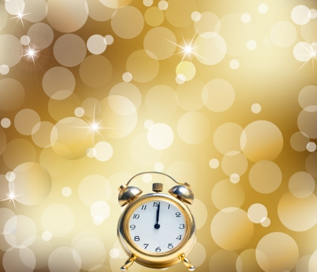 A Happy New Year Clock Striking Midnight abstract Lights on gold background photo